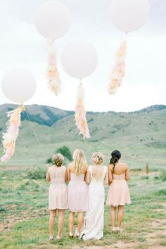Wedding detail inspiration: Big Day photos!  Instead of having the same old wedding party photos on your special day, why not add some whimsy and pizzazz with some creative (but still pretty) props? Like big balloons!