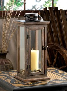 Features:  -Material: Wood and glass.  -The lantern can be hung on a wall lantern holder.  Style: -Contemporary.  Finish: -Brown.  Holder Material: -Metal. Dimensions:  Overall Height - Top to Bottom: