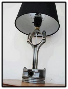 Man Cave lamp. Beer bottle opener ...^ to the one who put the above caption on you're an idiot. this is in no way a beer bottle opener it is a piston connected to a rod. and fyi i am a woman and know what this is!!