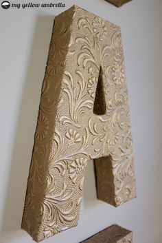 Wow!!!  How To:  Faux Metal Wall Letters  MyYellowUmbrella.comn ... paper mache letters and scrapbook paper!