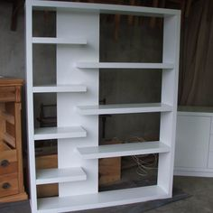 painted modern bookcase Built In Furniture, Industrial Furniture, Furniture Design, Furniture Makers, Modern Bookcase, Built In Bookcase, Bookcases, Wood Slat Wall, Wood Slats