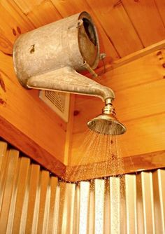 Cute idea for a garden shower - run standard plumbing through a watering can - via easyhomestead.