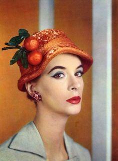 Jean Barthet in a fruit adorned hat, 1956