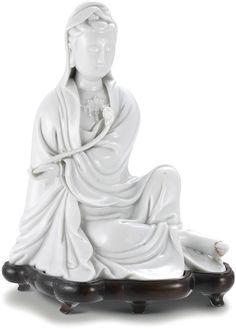 A Dehua 'Blanc-de-chine' seated figure of Guanyin, Qing dynasty, 18th century