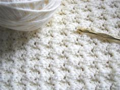 This easy stitch is perfect for an afghan or blanket. It is just sets of 3 stitches, one single crochet and two doubles. Once you get into the hang of it, you can do it in your sleep!