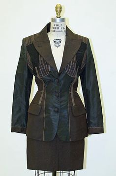 Suit- Designer: Jean Paul Gaultier. 1987 French Synthetics. Great example of a structured suit for an empowered woman. suit has depth because of the craftsmanship.