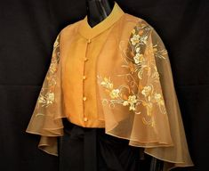Modern filipiniana inspired silk hand-painted cape blouse philippine national co Saree Blouse Neck Designs, Fancy Blouse Designs, Designs For Dresses, Blouse Patterns, Skirt Patterns, Coat Patterns, Sewing Patterns, Stylish Blouse Design, Mode Hijab