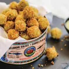 Fried Olives Are Delicious 1 Egg yolk ⅔ cup Grapeseed oil (or a blend of canola and mild olive oil) ½ teaspoon Kosher salt 1 clove Garlic ½ teaspoon Red wine vinegar 2 tablespoons All-purpose flour 1 Egg, beaten well ½ cup Panko bread crumbs 30 Anchovy‐stuffed Manzanilla olives (one 350g can, drained) Canola or peanut oil, for frying