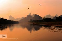 Foggy Yangshuo China. by ralphied  china colour fog light mountains reflections river sunset travel water yangshuo Foggy Yangshuo Chin
