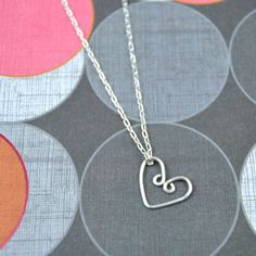 Learn some beginner wire wrapping to create a simple wire heart necklace. String it on a delicate chain for an easy DIY gift or Valentine's Day accessory! #wirejewelry