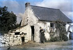Photos of Ireland, 1920's.   Image by Clifton R. Adams, (c) National Geographic.  Family stand outside their cottage.