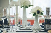 milk glass vases & hurricanes w/ floating candles