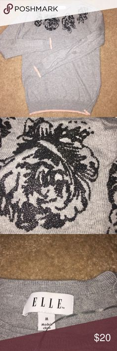 beautiful sweater! Sweater is in great condition. No tears, runs or damages. I love the beading detail of the flowers and a hint of pink along the hem line. Elle Sweaters Crew & Scoop Necks