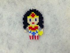 This is the Awesome Wonder Woman !! It is about 1.75 x 1.25 inches. You can have it as either a necklace or key chain. The necklace is Ball chain and it's about 24 inches long. I attach it with a jump ring. If you prefer another type of necklace let me know and we will see what we can come up with. Earring can be made but at a different price, contact me! Every beaded item has been handmade by me, individually stitching one Miyuki Delica seed bead at a time with a needle and Wildfire…