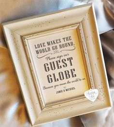A custom sign for a guestbook globe or map | Ways to Use Maps and Globes in Your Wedding Decor