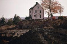 Near Cadiz, Ohio, a coal company stripped mined the land surrounding this abandoned house.