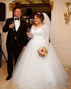 This pretty long sleeve plus size wedding gown has a ball gown skirt. The illusion neckline is scooped close to the neck. the sheer lace sleeves also add to the bridal fashion design. Elegant plus size wedding dresses like this can be totally customized to your personal taste & style. Modest designs like this are in our collection. But we can also work from any photo you have. For as US dress makers we can make a #replica of any bridal gown from a picture. Email us from our site for pricing…