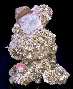 <3 Combination of lavender Fluorite, Arsenopyrite, and Rhodochrosite on   a matrix of sharp Muscovite crystals.
