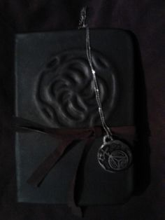 Book of Shadows Cassie Blake and Necklace (Secret Circle) Book is Blank. $99.00, via Etsy.