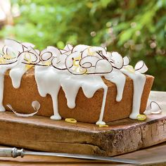 Garnish this pound cake with flaked coconut or, for a dressier look, curly shavings of coconut.  See the Test Kitchen note below for...