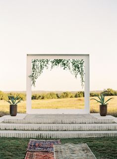 This chic ceremony structure was decorated with trailing leaves.
