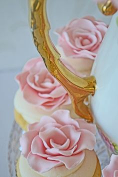 mademoiselle-rose-things: Gold teapot handle and pink ruffled rose cupcake.