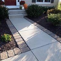 Pavers lining the sidewalk/driveway� great way t