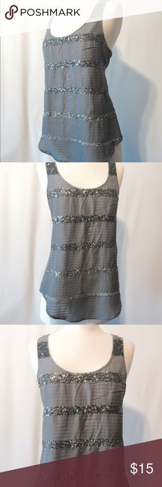 """✨ American Eagle Grey Sparkle Stripe Tank Why be basic when you can sparkle? Racer back tank top in gray on gray horizontal stripe with bands of tonal sequence dreading. Shirttail hem.   59% cotton 41% cotton  Dry Clean or hand wash   38"""" bust  27"""" overall length American Eagle Outfitters Tops Tank Tops"""