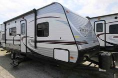 2016 New Heartland Pioneer BH250 Travel Trailer in Indiana IN.Recreational Vehicle, rv, 2016 Heartland PioneerBH250, Bike Rack, Black tank flush, Enclosed Underbelly, Night shades, Pioneer Value Package, Power Awning w/ LED Light Strip, POWER STAB JACKS, Power Tongue Jack, RVIA Seal, Spare Tire and Carrier, Winterization of Unit,