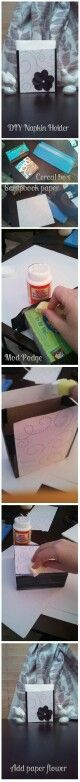 DIY napkin holder made from a cereal box, Mod Podge and scrapbooking paper.