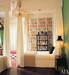 Yes yes yes to the whole thing. Kelly green walls, two cream canopied beds, shots of black and cobalt, and that fabulous Biblioteque wallpaper (Brunschwig? I'm not entirely sure) and oh yes, I see you back there hot pink silk x-bench.