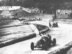 Tazio Nuvolari (Alfa Romeo) leads Bernd Rosemeyer (Auto Union) at the 1936 Italian Grand Prix.