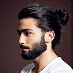 Fresh and groomed with a beard and man bun.