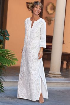 In the tradition of the Mola, each cotton work of art is cut out, layered and then handsewn to perfection. The end result is a Contadora Caftan garment of unique and elegantly comfortable beauty.