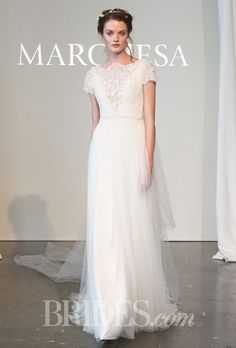 Grecian-inspired draped tulle A-line wedding dress with a high neckline, re-embroidered lace details, and short sleeves, Marchesa