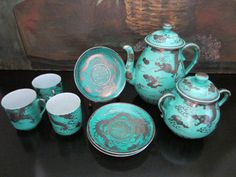 Asian tea set in porcelain turquoise hand painted silver dragon. Brief set, from vintage era, with stamp mark, attributed to Kanji Japan, with extreme fragility. The silver dragon inlays are remarkabl