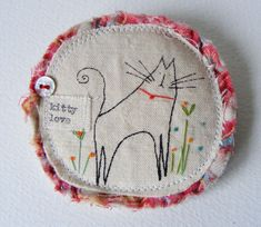 kitty brooch--make into assorted animal necklaces for little ones.