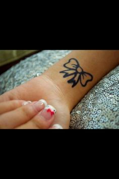 Love this bow tattoo but filled in pink :)
