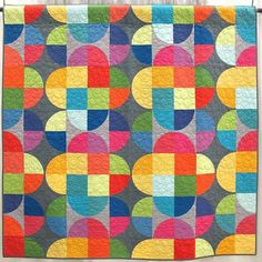 Capsule by Jen Carlton Bailly. Portland, Oregon. Quilted by Nancy Stovall. Would be a fun way to practice simple curved piecing.
