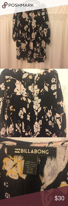 Black baby doll tunic with pink and yellow flowers Billabong floral tunic ! Great for wearing with black leggings in the fall or with white pants or shorts in the summer Billabong Tops