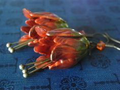 handpainted earrings in Tangerine Tango, Pantone 2012 color of the year, from Coral Stig.  Findings from B'sue Boutiques!
