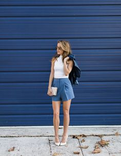Cropped white turtleneck tank with navy blue suit shorts- The Style Bungalow