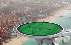 Play on the world's highest tennis court at the Burj Al Arab in Dubai.   41 Adventures To Add To Your Bucket List