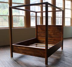 Reclaimed barn wood canopy bed