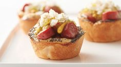We don't take hot dogs lightly; they have endless potential outside of their buns, and we want the world to know about it. Case in point -- these brilliant muffin-tin cups made with biscuit dough.