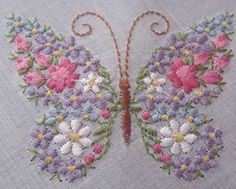 Gorgeous, colorful butterfly is made up of tiny embroidered flowers. There are white daisies, pink roses and rosebuds, with small blue and white forget-me-nots. Crisp white hankie has original gold foil label. Reads All Cotton, Made in Switzerland. Butterfly Embroidery, Butterfly Crafts, Silk Ribbon Embroidery, Hand Embroidery Patterns, Machine Embroidery Designs, Embroidery Stitches, Embroidered Butterflies, Embroidery Applique, Bordado Popular