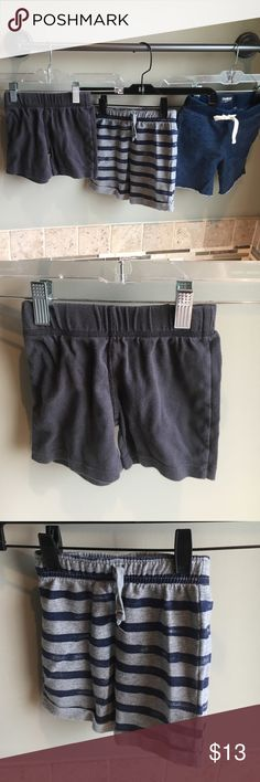 "Shorts bundle Grey cotton shorts (carters). Striped shorts (jumping beans) navy/grey with drawstring and cuff on bottom of shorts  have a ""distressed"" look. Navy (OshKosh) with drawstring are cut offs with adorable star patch pocket on rear. Osh Kosh Bottoms Shorts"