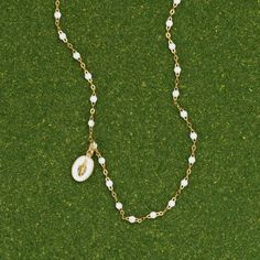 White Virgin Mary Medal by Gigi Clozeau