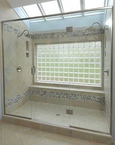 Master bath shower @Jill Meyers George with large glass block window. Sunlight with privacy!