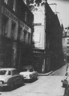The rue du Sabot in 1950 [Vian p272 credit Roger Viollet] Richard Seaver's warehouse is the building on the left, where the two cars are parked. Merlin was published here.